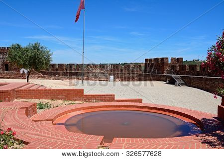 Courtyard And Gardens Of The Medieval Castle With Battlements And Tower To The Rear, Silves, Portuga