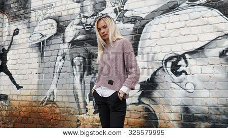 Elegant Woman Posing On Grafitty Sport Background. Concept Of Activity And Sport