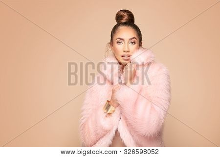 Fashionable Smiling Girl In Pink Eco Fur.