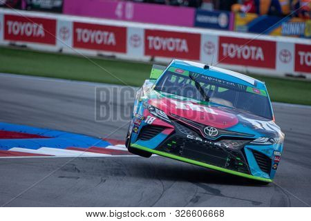 September 29, 2019 - Concord, North Carolina, USA: Kyle Busch (18) battles for position for the Bank of America ROVAL 400 at Charlotte Motor Speedway in Concord, North Carolina.
