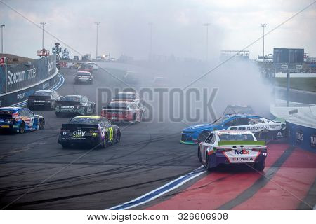 September 29, 2019 - Concord, North Carolina, USA: Denny Hamlin (11), Alex Bowman (88) and Erik Jones (20) wreck during the Bank of America ROVAL 400 at Charlotte Motor Speedway