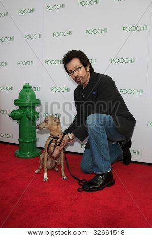 LOS ANGELES, CA - MAY 3: George Chakiris at the opening of the Pooch Hotel on May 3, 2012 in Hollywood, Los Angeles, CA. The Pooch Hotel is billed as a luxury hotel and daycare exclusively for dogs.
