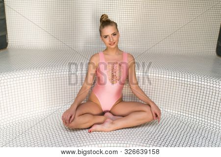 Beautiful girl relaxing in a turkish steam room
