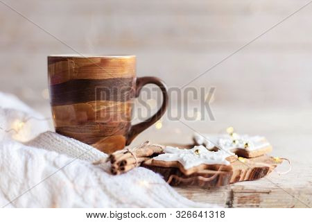 Christmas Still Life. Mug Of Hot Steamy Coffee, Gingerbread Cookies At Wooden Background With Glares