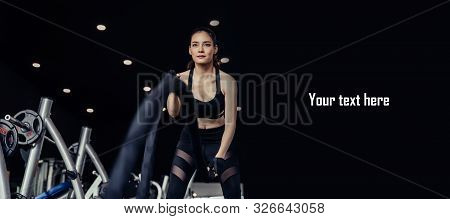 Copy Space. Asian Young Strong Woman Slim Body Training And Working Out With Battle Rope In Fitness