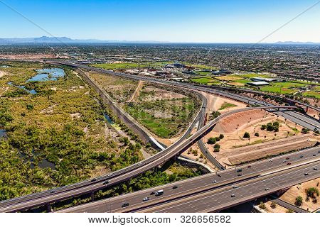 Aerial View Looking From The Northwest To The Southeast Of The Loop 101 & 202 Freeways At The Salt R