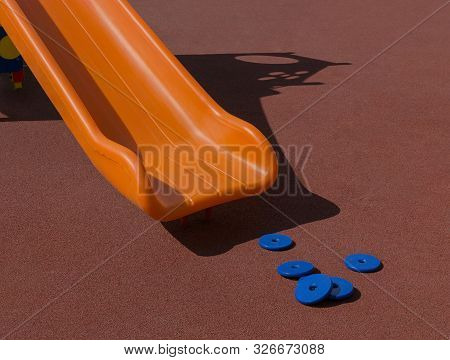 Plastic Chute Of Slide Is On Playground With Coating Crumb Rubber. Sunny Day. Copy Space