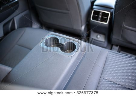 Armrest In The Car With Can Holders, Rear Seats