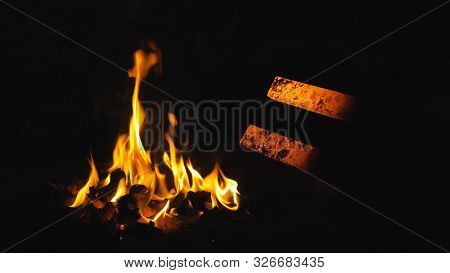 Forge Fire In Furnace. Blacksmith Tempers A Steel Product In A Stove. Smithy Forging For Hardening A