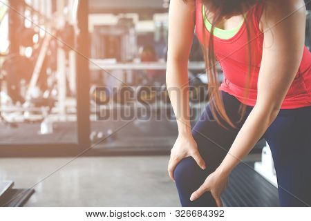 Body Pain. Close-up Of Beautiful Female Body With Pain In Knees. Closeup Of Girl Feeling Joint Pain
