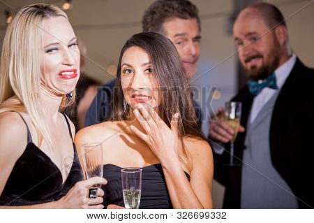 Two Pretty Women Cringing Over Attention From Men At Party