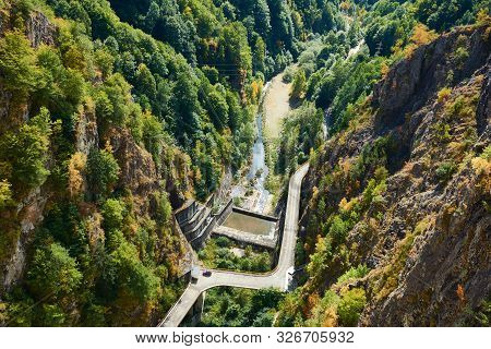 Hydropower Construction, Waterworks Dam Vidrau On Transfagarash Highway In Romania. Dam And Reservoi
