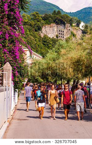 Monterosso Al Mare, Italy - September 02, 2019: People Walking By The Seafront Promenade Decorated W