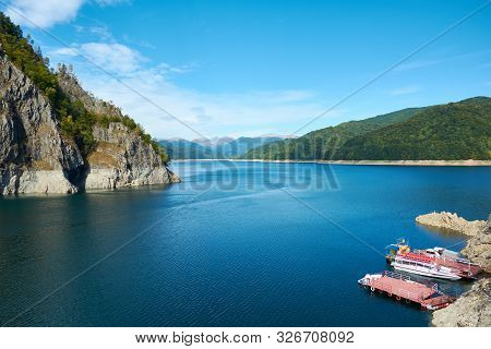 Dam And Reservoir On Lake Vidraru. Hydropower Construction, Waterworks Dam Vidrau On Transfagarash H