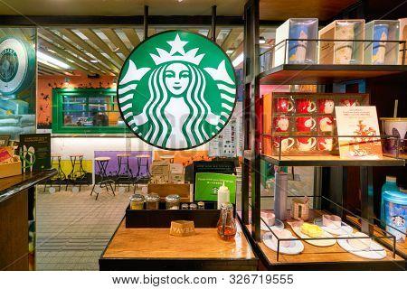 HONG KONG, CHINA - CIRCA JANUARY, 2019: Starbucks Coffee sign seen at a coffeeshop in Hong Kong.
