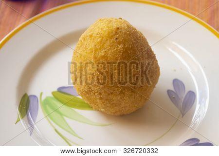Street Food: Fried Sicilian Arancine In A Dish
