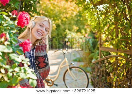 Girl Ride Bicycle For Fun. Blonde Enjoy Relax In Park Or Garden. Active Girl With Bicycle. Motion An