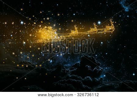 Golden snowy flying Santa Claus on the background of the night sky.