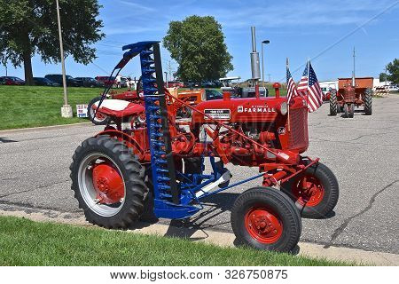 Yankton, South Dakota, August 19, 2106: The Restored Farmall Cub With An Attached Hay Mower Is Displ