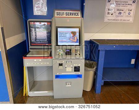 Orlando,fl/usa-10/7/19:  A Self Service Postage Machine In An United States Postal Service, Usps, Of
