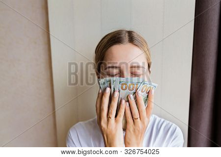 Businesswoman Got Cash Money. Richness And Wellbeing Concept. Get Cash Money Easy And Quickly. Smell