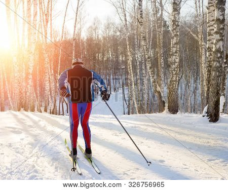 Training On Cross-country Skis In The Winter Forest, A Nice Suit For Workouts.