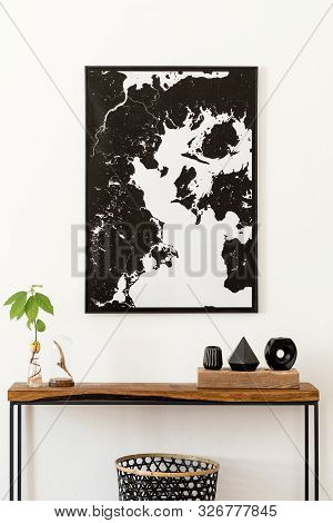 Modern Scandinavian Interior Of Living Room With Wooden Console, Avocado Plant, Black Vases, Basket