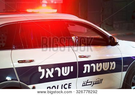 Israeli Police Car. The Inscription On The Door Of The Car Is In Hebrew And In Arabic. Israeli Polic