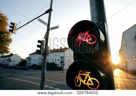 Wide Angle View On A Traffic Light For A Cycling Lane Showing Red And Yellow Bicycle Symbols In Brig