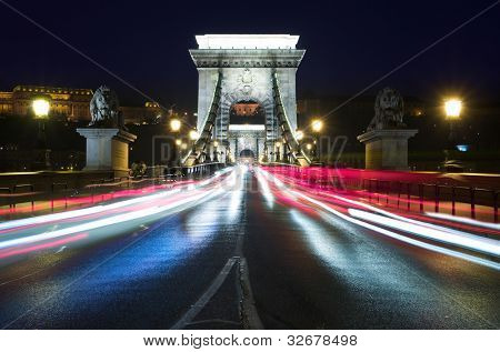 night view of Chain Bridge and light trails in Budapest