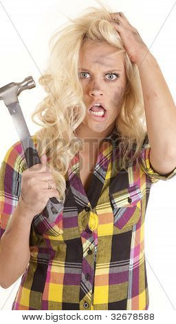 Woman Frustrated With Hammer In Hand