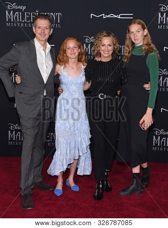 LOS ANGELES - SEP 30:  Gildart Jackson, Piper Quincey Jackson, Melora Hardin and Rory Jackson arrives for 'Maleficent: Mistress of Evil' World Premiere on September 30, 2019 in Hollywood, CA