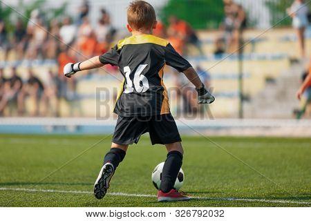 Young Soccer Goalie Goalkeeper. Young Boy Soccer Goalie. Soccer Game On Sunny Summer Day