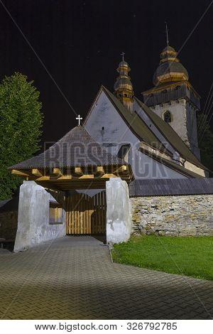 Ancient Historical Gothic Catholic Church At Night,  Outside. Village Smrečany, Liptov Region, Slova