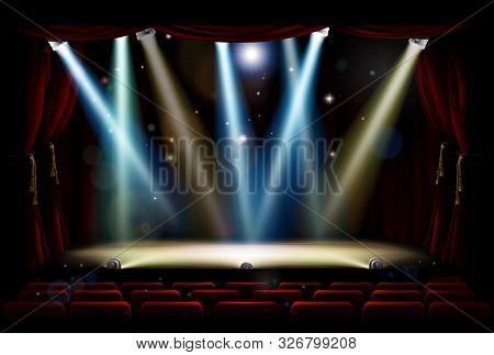 A Theatre Or Theater Stage And Audience Seating With Footlights, Spotlights And Red Curtains