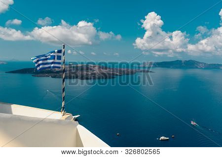 Greek Flag In The Foreground Of The Camera. An Amazing And Unbelievable Seascape Of The Aegean Sea A