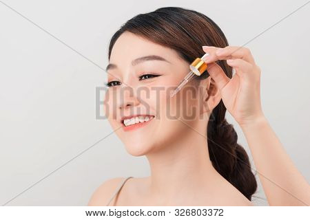 Photo Of A Beautiful Young Pretty Asian Woman With Healthy Skin Take Care Of Her Skin With Cosmetics