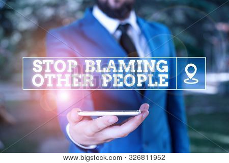 Handwriting text writing Stop Blaming Other People. Concept meaning Do not make excuses assume your faults guilt Businessman in blue suite stands with mobile phone in hands. poster