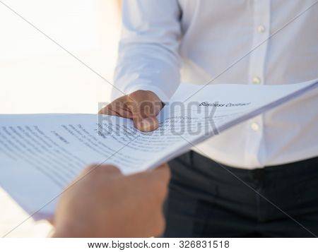 Businesswoman Giving Contract To Partner For Signing. Hands Of Business People Holding Documents. De