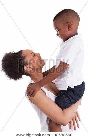 Little Black Boy embracin Her Mother