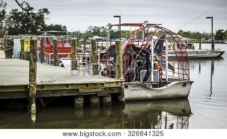 New Orleans, Usa - Dec 17, 2017: Air Boat Moored To A Jetty. Back View Featuring Four Powerful Metal