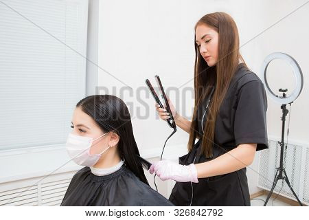 The Work Of A Hair Stylist To Straighten Hair Restores Keratin And Straightens