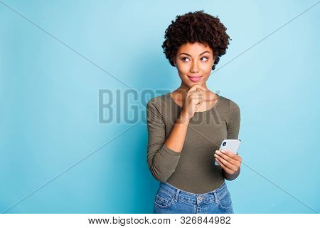 Photo Of Cunning Smirking Puzzled Interested Dark Skinned Youngster Touching Her Chin In Thought Of