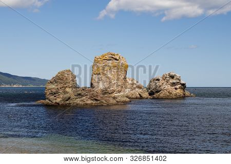 A Beautiful Stone Outliers Or Rock Formations Near The Coast Of The Sea Of Okhotsk. Cape Velikan, Is