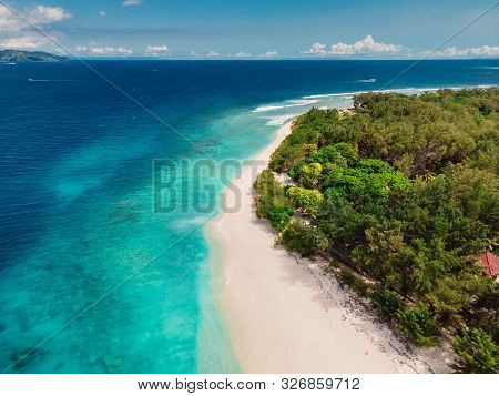 Tropical Island With Paradise Beach And Turquoise Ocean. Aerial View. Gili Islands