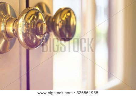Close Up Of Metal Handle On A Old Wooden Door,golden Door Knob. Close Up Of Metal Handle On A Old Wo