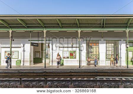 Vienna, Austria - Jul 23, 2009: People Wait For The Next Train At Station Waehringer  Strasse In Vie