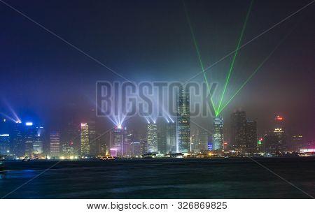 Kowloon, Honkgong - Jan 5, 2010:   Hong Kong Famous Laser Harber Show Seen From Kowloon Harbor In Ko