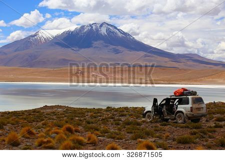 Off Road In The Bolivia Desert. 4x4 Vehicles Crossing The Beautiful Landscapes Of The Highlands. Mou