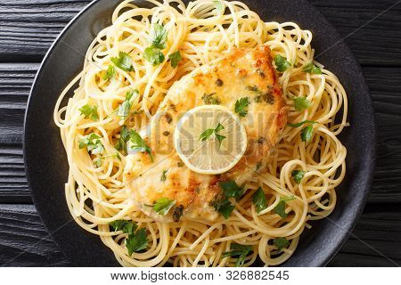 Cooked Chicken Francaise With Spaghetti In Lemon Wine Gravy Close-up On A Plate. Horizontal Top View
